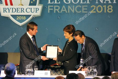 George O'Grady presents the winning document to Chantal Jouanno, France's Minister of Sport