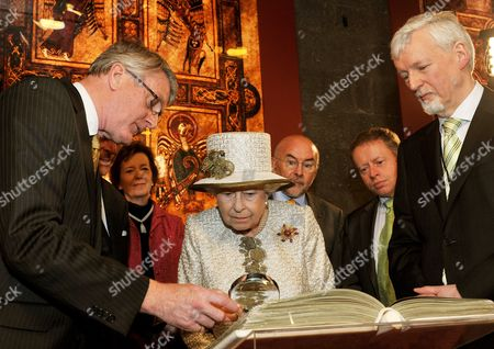 Queen Elizabeth II in the Long Room at Trinity College Library with Provost of Trinity College Dublin Dr John Hegarty (R)