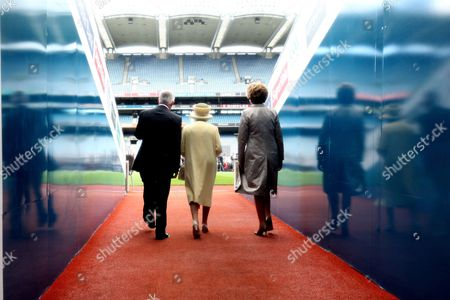 Christy Cooney President of the GAA, Queen Elizabeth II and President Mary McAleese walk from the tunnel into Croke Park