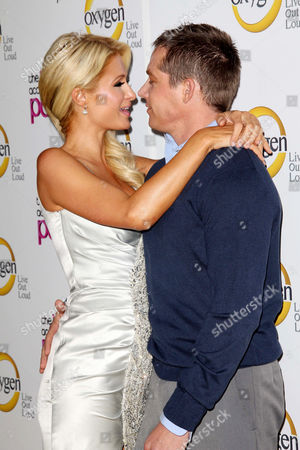 Stock Picture of Paris Hilton and Cy Waits