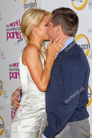 Stock Photo of Paris Hilton and Cy Waits