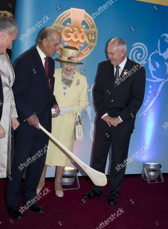 Prince Philip, Queen Elizabeth II and Christy Cooney President of the GAA with a hurley at Croke Park