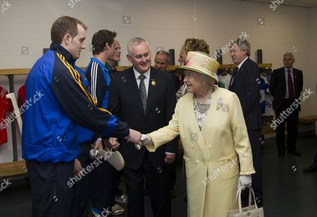 Christy Cooney, President of the Gaelic Athletic Association, introduces Queen Elizabeth II to hurling players at Croke Park