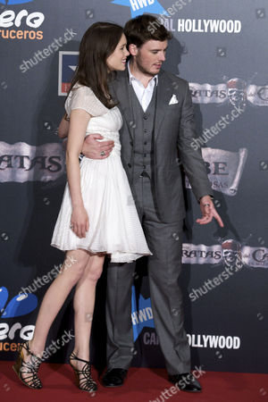 Astrid Berges-Frisbey and Samuel Claflin
