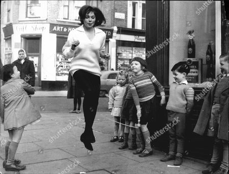 Actress Kathleen Breck Skipping With Children In Notting Hill.