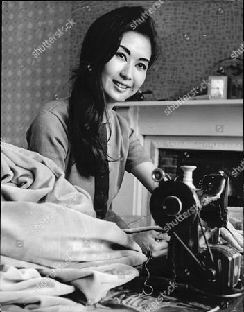 Lucille Soong 22 Actress And Model. Pictured Sewing Curtains For Her Belsize Park Flat.