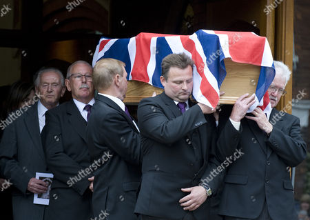 Stock Image of The coffin of heavyweight boxing legend Sir Henry Cooper leaving Corpus Christi Church