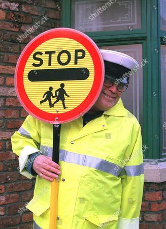 Coronation Street: Sunday 30 April 2000  Jack Duckworth (William Tarmey) in his new job as a lollipop man.