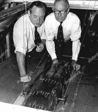 World Land Speed Record Holder Donald Campbell (left) And His Chief Mechanic Leo Villa Examine A Model Car