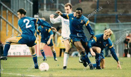 Football Club Games 1991 / 1992 .. Wimbledon Vs Leeds Shows: Gary Mcallister Of Leeds Is Overwhelmed By Gary Elkins Robbie Earle And Warren Barton.