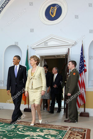 President Barack Obama, President of Ireland Mary McAleese, with (background) First Lady Michelle Obama and Dr Martin McAleese at Aras an Uachtarain, Dublin