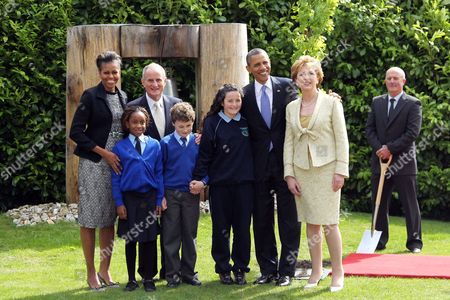 Stock Picture of First Lady Michelle Obama, schoolchildren Onyedika Ukachukwu, Dr Martin McAleese, Colm Dunne, Maragaret McDonagh, President Barack Obama, President of Ireland Mary McAleese, and Robert Norris, Head Gardener; after a tree planting ceremony at Aras an Uachtarain, Dublin