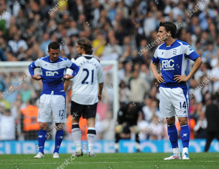 Matt Derbyshire and Barry Ferguson of Birmingham look dejected as they are relegated