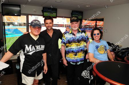 (L-R) Bruce Johnston, John Stamos, Mike Love and John Cowsill attend the Florida Marlins Vs. Tampa Bay Rays