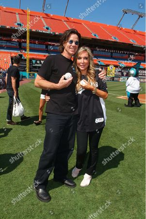 John Cowsill and Marysol Patton attend the Florida Marlins Vs. Tampa Bay Rays game Super Saturday Concert, before throwing the first pitch