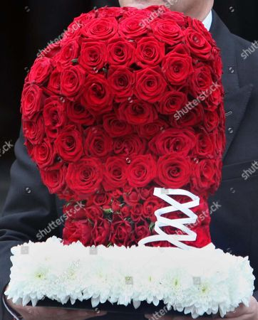 A boxing glove shaped floral tribute at the funeral of Sir Henry Cooper