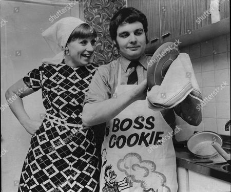 Songwriter Tony Hatch With Wife Singer Jackie Trent Doing The Household Chores. Man Washing Up.
