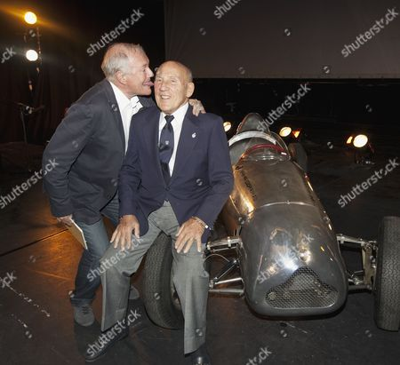 Journalist Murray Smith sticking his tongue into the ear of Sir Stirling Moss
