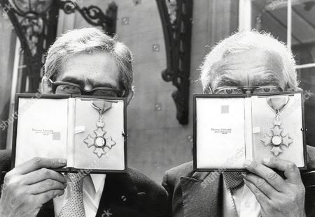 Writer/broadcasters Dennis Norden (tie) And Frank Muir (bow Tie) At Buckingham Palace After Being Awarded Their Cbe's. (1980 Pic).