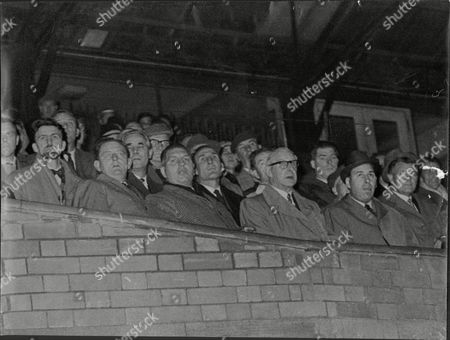 Stock Photo of Football Managers And Scouts Watch A Game At Stamford Bridge. Front Row L To R: Jimmy Hill Jack Conley And Bert Head Cyril Spiers Trevor Morris And Billy Lane