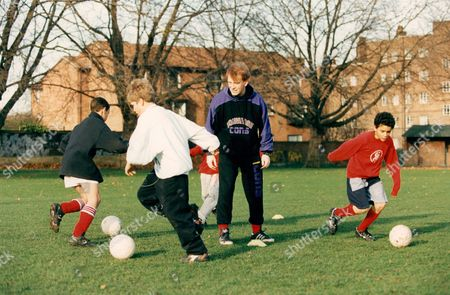 Stock Image of Actor John Salthouse Supervises A Training Session For West London Youngsters. John Is Starring In A Tv Play 'hero To Zero' Which Examines The Topical Theme Of Soccer Coaching Of Youngsters.