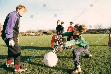 Stock Photo of Actor John Salthouse Supervises A Training Session For West London Youngsters. John Is Starring In A Tv Play 'hero To Zero' Which Examines The Topical Theme Of Soccer Coaching Of Youngsters.