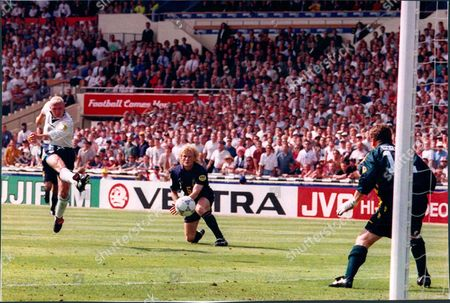 Football International European Championships 1996 Group A. England V Scotland 2-0. Colin Hendry Looks On As Paul Gascoigne Shoots Past Andy Goram.
