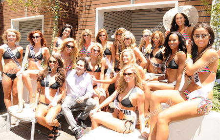 Miss USA 2011 contestants and Palms Resort owner George Maloof