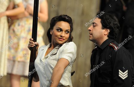 Stock Image of Danielle De Niese (Adina) and Rodion Pogossov (Sergeant Belcore)