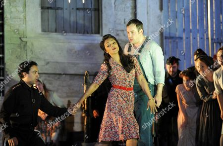 Stock Picture of Rodion Pogossov (Sergeant Belcore), Danielle De Niese (Adina) and Stephen Costello (Nemorino)