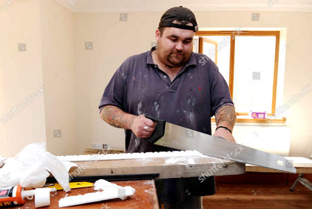 Michael Carroll working as a painter and decorator