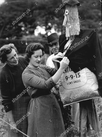 Sir Guy And Lady Salisbury Jones And Their Daughter Mariette Salisbury Jones With Scarecrow For Feature On Wine Making In 1955.