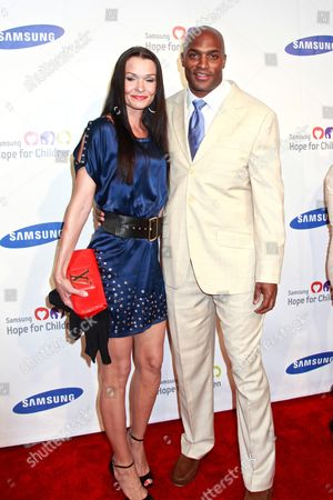 Amani Toomer (R) with guest
