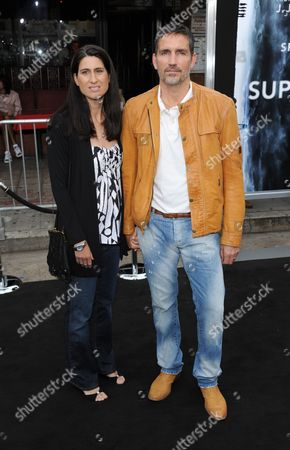 Stock Picture of James Caviezel and wife Kerri Browitt