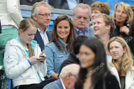 Pippa Middleton among the crowd on Centre Court with friend George Percy