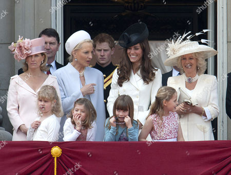 Sophie Countess of Wessex, Lady Louise Windsor, Tim Laurence, Princess Michael of Kent, Prince Harry, Catherine Duchess of Cambridge and Camilla Duchess of Cornwall with Lady Louise Windsor, Estella and Eloise Taylor and Margarita Armstrong-Jones in front row