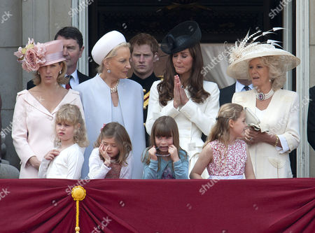 Sophie Countess of Wessex,Tim Laurence, Princess Michael of Kent, Prince Harry, Catherine Duchess of Cambridge and Camilla Duchess of Cornwall with Lady Louise Windsor, Estella and Eloise Taylor and Margarita Armstrong-Jones in front row