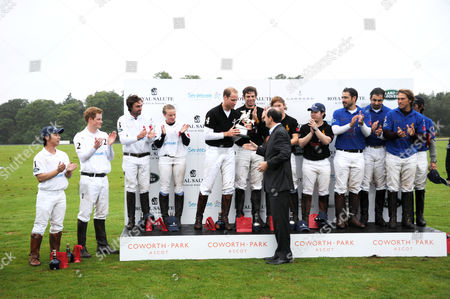 Stock Image of Prince William receives the trophy from Christian Porta CEO of Chivas Brothers