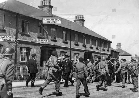 The Symons Avenue Siege In Chatham Kent. June 6th 1951. Alan Derek Poole 20 Sought For The Killing Of Police Constable Baxter Was Brought Dead From His Home (number 114) After Being Found In The Loft. Police Had Launched A Tear Gas Attack After He Shot At Them. Chief Superintendent Charles Broughton Is Pictured Centre