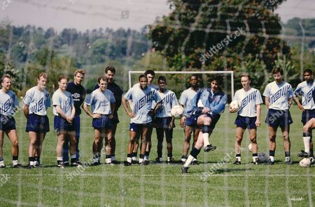 Stock Image of England's European Championship Squad In Training. Neil Webb Taking Penalty. L-r Trevor Steven Alan Shearer David Batty Chris Woods Tony Dorigo David Seamen John Barnes Martin Keown Tony Daley Ian Wright Lee Dixon Alan Smith Carlton Palmer