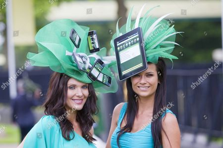 Paddy Power girls (L) Jules Wheeler and (R) Emily Jane Betteridge promote Paddy Power's new app for i-phone and i-pad.