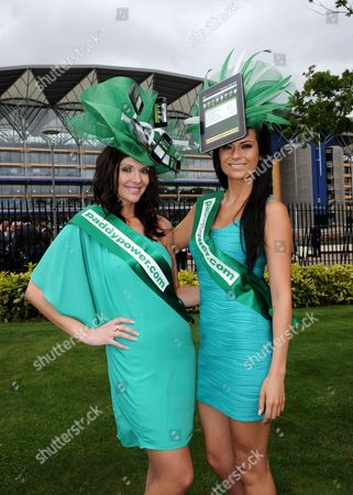 Stock Photo of Paddy Power girls (L) Jules Wheeler and (R) Emily Jane Betteridge promote Paddy Power's new app for i-phone and i-pad.