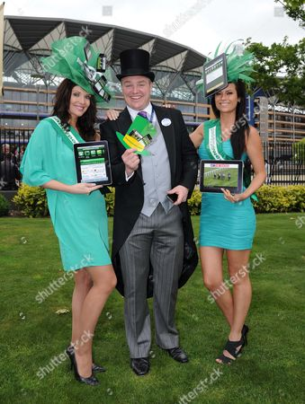 Stock Image of (C) Paddy Power with (L) Jules Wheeler and (R) Emily Jane Betteridge promote Paddy Power's new app for i-phone and i-pad.