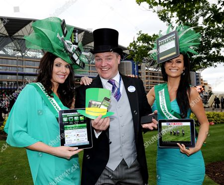 (C) Paddy Power with (L) Jules Wheeler and (R) Emily Jane Betteridge promote Paddy Power's new app for i-phone and i-pad.