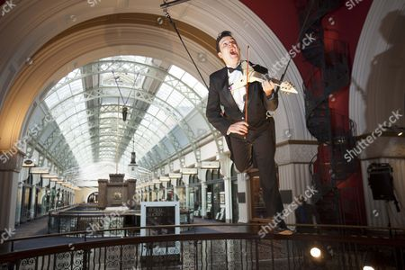 Editorial photo of Aerial violinist Shenzo Gregorio performs while suspended under the Queen Victoria Building Dome, Sydney, Australia - 16 Jun 2011