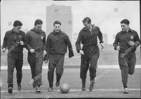 Editorial photo of West Ham Football Club Are Seen During Training. From Left: Harry Hooper Dave Sexton Tommy Dixon George Dick And Ken Tucker