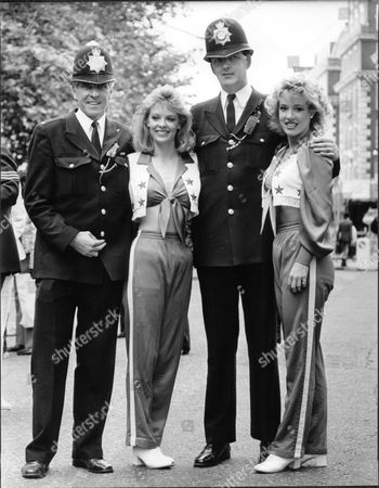 American Football Cheerleaders Outside The American Embassy. Pictured L-r: Pc Mike Conroy Krista Parker Pc Ken Morrison Kelly Mcgonagill.