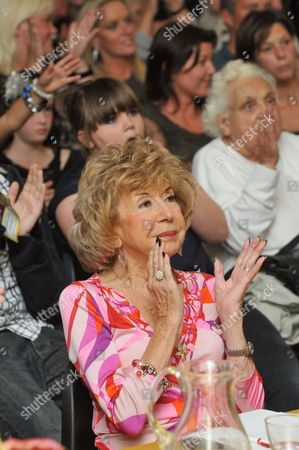 Julie Cowell judging a singing contest in Rottingdean
