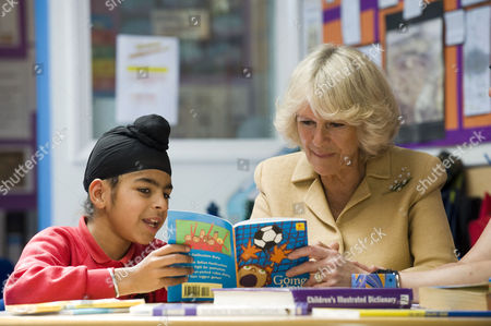 Camilla Duchess of Cornwall with pupil Abhijit Aroia