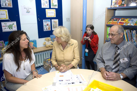 Camilla Duchess of Cornwall with helpers Suzanne Diver and David De Cruz and young photographer Tahlia Klein